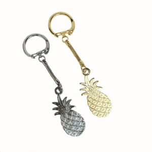 "Pineapple Key chains offer a latch top and are available in silver or gold. The pineapple is 1.75"" tall. .$5.50 Each 1 to 11, $3.75 Each 12 to 99, $3.00 Each 100+"